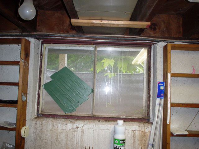 an old rusted basement window with a steel frame in manitowoc images