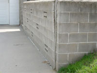 A retaining wall separating from the adjoining walls in Wausau, Manitowoc, Neenah, Stevens Point, Wisconsin Rapids, De Pere, Marshfield, Menasha, Kaukauna, Rhinelander, West Bend, Merrill, Sturgeon Bay, Shawano