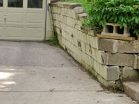 a failing retaining wall around a driveway in Green Bay