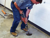Coring the concrete of a concrete slab floor in Menasha