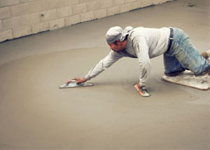 smoothing out the grout in a slab releveling project in Manitowoc