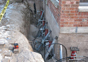 Foundation push piers installed around a house with a foundation settlement issues in Antigo
