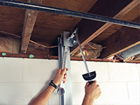 Straightening a foundation wall with the PowerBrace™ i-beam system in a Wisconsin Rapids home.