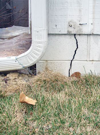 foundation wall cracks due to street creep in Schofield