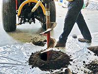 Digging the hole used for wall anchor installation in Marinette.